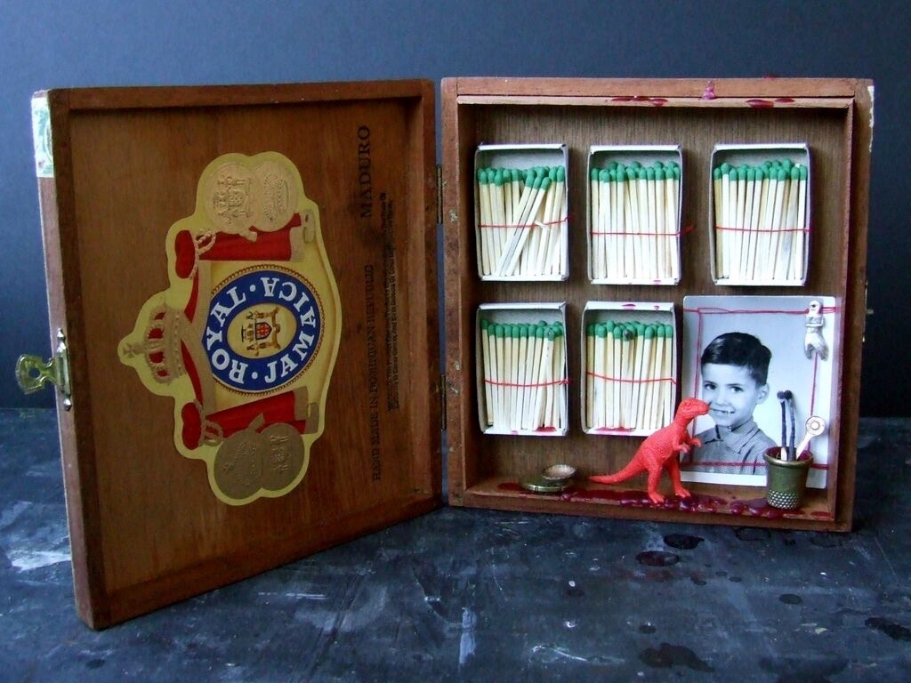 Collected objects, including cigar box, matches, toy dinosaur and photograph, 2013