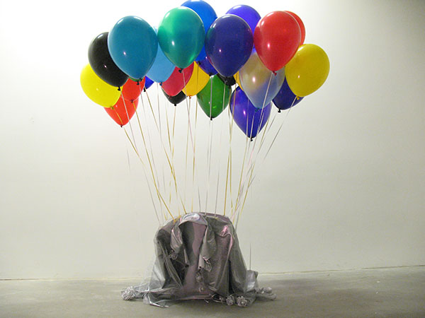 Helium filled balloons, holding up copy of Cortezuma's jacket made of plastic fabric, netting, plastic flowers, 2009