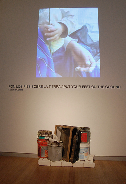 Dirt, rocks, fabric, polypropylene sacks, barrow from grandparents from Mexico, slip casted bricks, wood, plastic buckets, video projections  22 x 12 x 16 feet, 2013