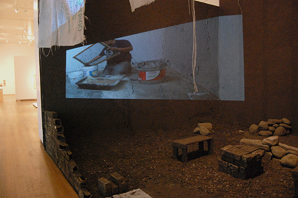 Dirt, rocks, fabric, polypropylene sacks, barrow from grandparents from Mexico, slip casted bricks, wood, plastic buckets, video projections,  22 x 12 x 16 feet, 2013