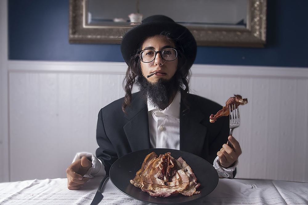 Archival pigment print, Hasidic Jew, bacon, ceramic plate, silverware, joint, 36 x 47 in., 2014